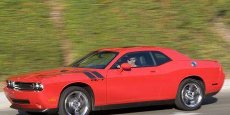 Tire, Wheel, Automotive design, Automotive tire, Vehicle, Hood, Infrastructure, Rim, Red, Automotive wheel system,