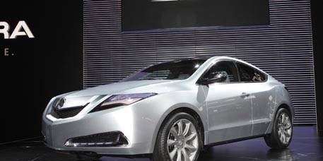 Motor vehicle, Mode of transport, Automotive design, Vehicle, Car, Headlamp, Glass, Automotive lighting, Alloy wheel, Automotive exterior,