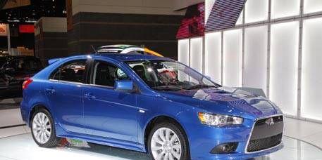 Tire, Motor vehicle, Wheel, Mode of transport, Blue, Automotive design, Product, Vehicle, Transport, Flag,
