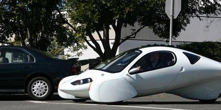 Motor vehicle, Mode of transport, Transport, Automotive design, Land vehicle, Car, Automotive parking light, White, Automotive mirror, Automotive wheel system,