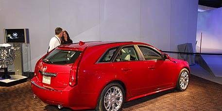 Tire, Wheel, Automotive design, Vehicle, Car, Red, Rim, Automotive tail & brake light, Alloy wheel, Vehicle door,