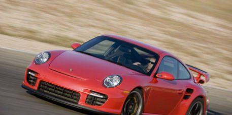Automotive design, Vehicle, Car, Rim, Red, Alloy wheel, Sports car, Performance car, Fender, Bumper,