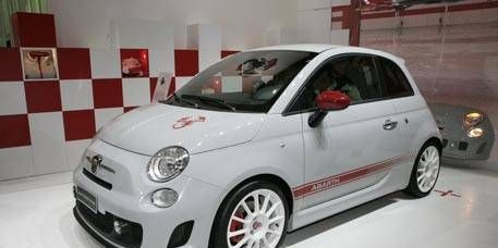 Motor vehicle, Wheel, Automotive design, Vehicle, Land vehicle, Car, Automotive wheel system, Red, Alloy wheel, Rim,