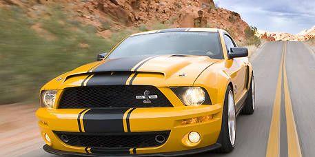 Automotive design, Daytime, Yellow, Hood, Headlamp, Automotive lighting, Grille, Landscape, Fender, Automotive exterior,
