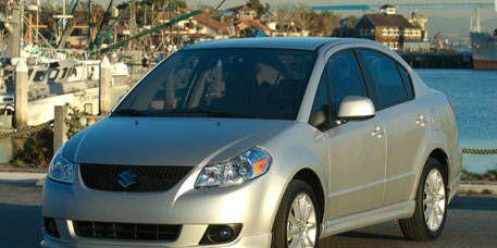 Motor vehicle, Tire, Wheel, Mode of transport, Automotive mirror, Blue, Daytime, Vehicle, Glass, Transport,