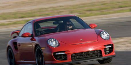 Wheel, Automotive design, Vehicle, Land vehicle, Red, Car, Rim, Performance car, Sports car, Alloy wheel,