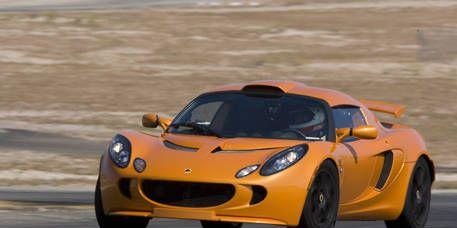Tire, Mode of transport, Automotive design, Vehicle, Yellow, Land vehicle, Photograph, Car, Hood, Supercar,