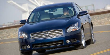 Motor vehicle, Tire, Automotive mirror, Wheel, Automotive design, Blue, Daytime, Vehicle, Transport, Automotive lighting,