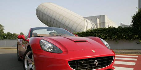 Mode of transport, Automotive design, Vehicle, Red, Car, Performance car, Automotive tire, Fender, Hood, Sports car,