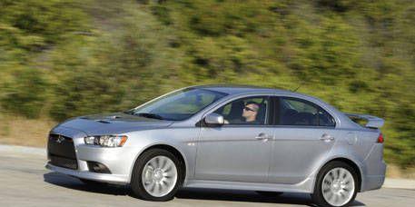 Tire, Wheel, Mode of transport, Automotive mirror, Daytime, Vehicle, Automotive design, Alloy wheel, Land vehicle, Car,