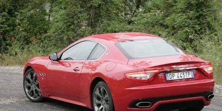 Tire, Mode of transport, Automotive design, Vehicle, Performance car, Vehicle registration plate, Red, Car, White, Fender,