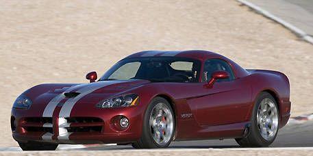 Tire, Automotive design, Mode of transport, Automotive tire, Vehicle, Automotive lighting, Rim, Red, Headlamp, Car,