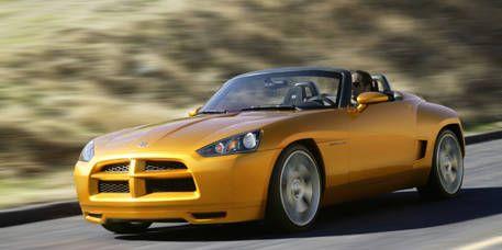 Automotive design, Yellow, Vehicle, Hood, Headlamp, Infrastructure, Car, Performance car, Fender, Automotive lighting,