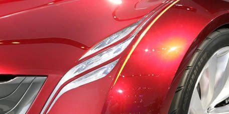 Automotive design, Automotive lighting, Red, Automotive exterior, Automotive tire, Fender, Carmine, Alloy wheel, Synthetic rubber, Tread,