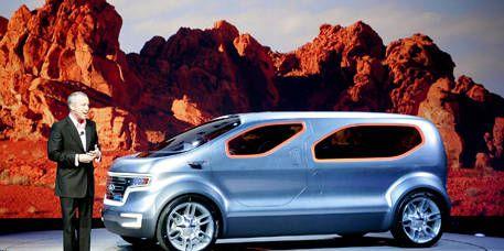 Motor vehicle, Automotive design, Automotive mirror, Vehicle, Car, Vehicle door, Alloy wheel, Automotive exterior, Fender, Suit,