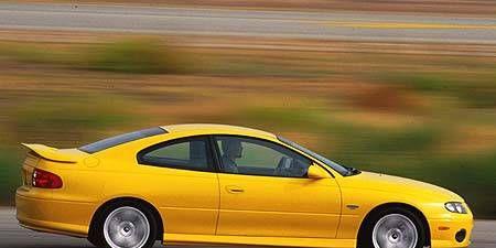 Tire, Wheel, Mode of transport, Automotive design, Vehicle, Yellow, Transport, Car, Hood, Fender,