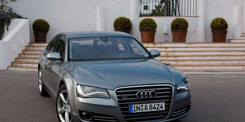 Tire, Automotive design, Vehicle, Land vehicle, Grille, Infrastructure, Headlamp, Vehicle registration plate, Car, Hood,