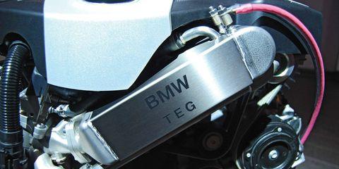 Motorcycle accessories, Motorcycle, Automotive fuel system, Engine, Carbon, Machine, Fuel tank, Automotive engine part,