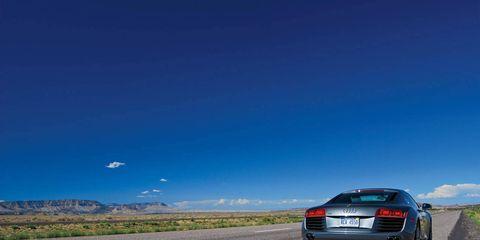 Tire, Automotive tail & brake light, Road, Automotive design, Sky, Automotive lighting, Vehicle, Vehicle registration plate, Infrastructure, Car,