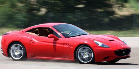 Tire, Wheel, Automotive design, Vehicle, Performance car, Red, Automotive tire, Rim, Car, Automotive lighting,