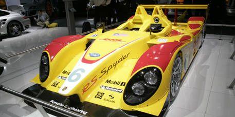 Mode of transport, Automotive design, Vehicle, Yellow, Land vehicle, Headlamp, Race car, Sports car, Automotive lighting, Auto part,