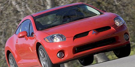 Tire, Automotive design, Automotive mirror, Vehicle, Land vehicle, Hood, Car, Red, Rim, Automotive tire,