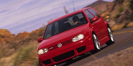 Automotive design, Vehicle, Land vehicle, Car, Red, Hatchback, Alloy wheel, Rim, Automotive lighting, Bumper,