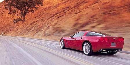 Tire, Motor vehicle, Wheel, Mode of transport, Road, Automotive design, Vehicle, Automotive lighting, Infrastructure, Performance car,