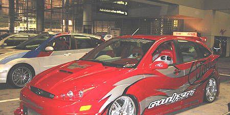 Tire, Wheel, Automotive design, Vehicle, Land vehicle, Car, Rim, Alloy wheel, Automotive tire, Red,