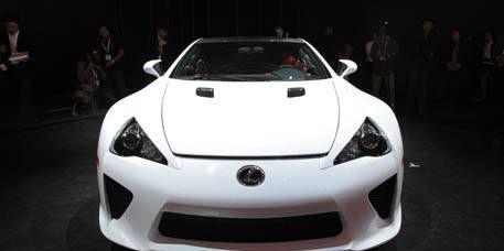 Automotive design, Vehicle, Car, Supercar, Photograph, White, Headlamp, Sports car, Performance car, Personal luxury car,
