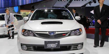 Motor vehicle, Vehicle, Event, Land vehicle, Car, Grille, Technology, Coat, Suit, Automotive mirror,