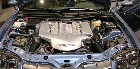 Engine, Automotive exterior, Grille, Automotive engine part, Metal, Personal luxury car, Hood, Luxury vehicle, Automotive air manifold, Fuel line,