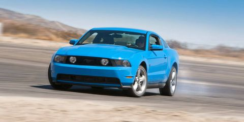 Tire, Automotive design, Blue, Daytime, Vehicle, Hood, Land vehicle, Automotive tire, Car, Automotive exterior,