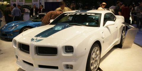 Automotive design, Land vehicle, Vehicle, Car, Automotive exterior, Hood, Fender, Sports car, Personal luxury car, Auto show,