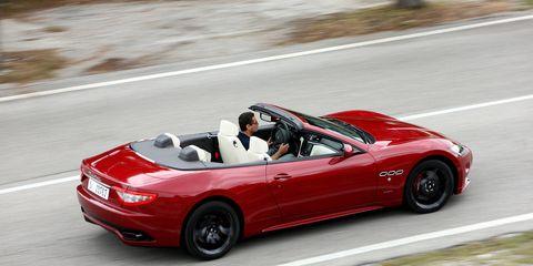 Tire, Wheel, Automotive design, Mode of transport, Vehicle, Road, Automotive mirror, Performance car, Car, Red,