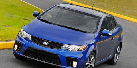 Motor vehicle, Blue, Mode of transport, Daytime, Automotive mirror, Vehicle, Automotive lighting, Land vehicle, Car, Headlamp,