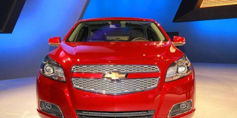 Motor vehicle, Automotive design, Daytime, Vehicle, Automotive lighting, Grille, Car, Hood, Headlamp, Red,