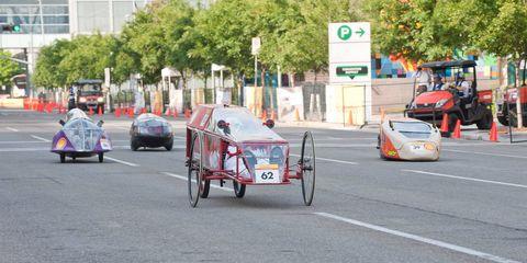 Wheel, Mode of transport, Land vehicle, Vehicle, Asphalt, Automotive parking light, Lane, Thoroughfare, Cart, Rickshaw,