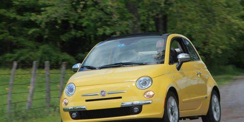 Tire, Motor vehicle, Automotive design, Vehicle, Yellow, Land vehicle, Rim, Car, Automotive tire, Automotive wheel system,
