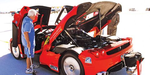Tire, Wheel, Motor vehicle, Automotive design, Vehicle, Automotive exterior, Automotive wheel system, Red, Automotive tire, Fender,