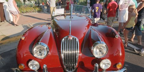 Mode of transport, Vehicle, Automotive design, Transport, Classic car, Land vehicle, Car, Red, Public space, Antique car,
