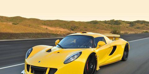 Mode of transport, Automotive design, Road, Yellow, Vehicle, Performance car, Headlamp, Supercar, Hood, Car,