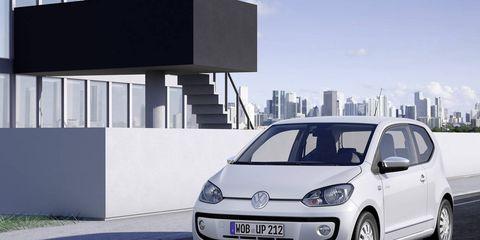 Motor vehicle, Automotive design, Daytime, Automotive mirror, Vehicle, Infrastructure, Transport, Car, Rim, Alloy wheel,