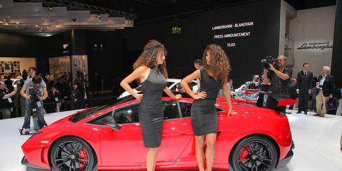 Clothing, Tire, Automotive design, Vehicle, Event, Land vehicle, Car, Alloy wheel, Exhibition, Auto show,