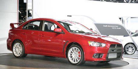 Tire, Wheel, Automotive design, Vehicle, Alloy wheel, Car, Automotive mirror, Automotive wheel system, Rim, Red,
