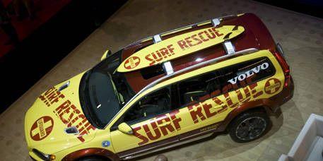 Motor vehicle, Vehicle, Shirt, Car, Fender, Automotive exterior, Automotive parking light, Automotive tire, Vehicle door, Toy vehicle,