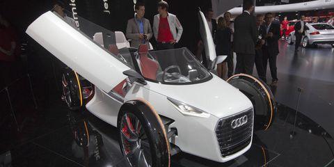 Tire, Motor vehicle, Wheel, Automotive design, Mode of transport, Vehicle, Event, Land vehicle, Car, Auto show,