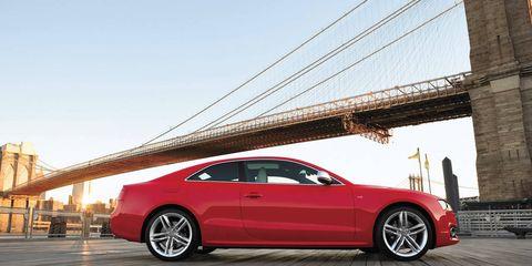 Tire, Wheel, Vehicle, Automotive design, Rim, Alloy wheel, Car, Red, Fender, Cable-stayed bridge,