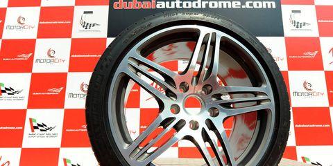 Tire, Wheel, Automotive tire, Alloy wheel, Automotive wheel system, Spoke, Rim, Synthetic rubber, Tread, Logo,