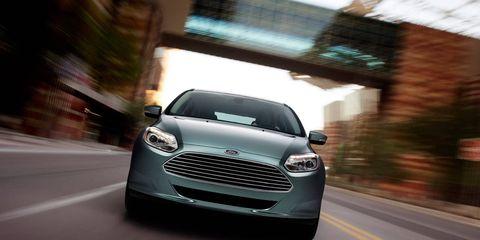 Motor vehicle, Automotive design, Daytime, Product, Vehicle, Grille, Headlamp, Infrastructure, Road, Car,